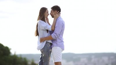 Couple Kissing. Romantic People In Love Kiss in Nature.