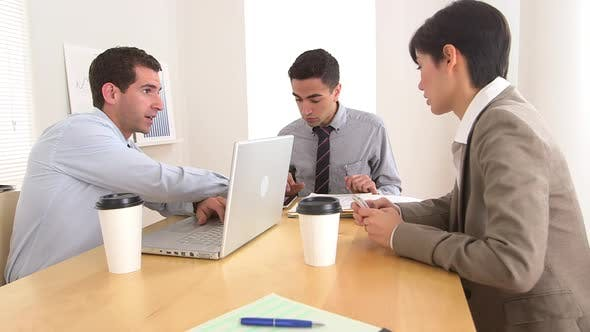 Thumbnail for Business partners working at desk