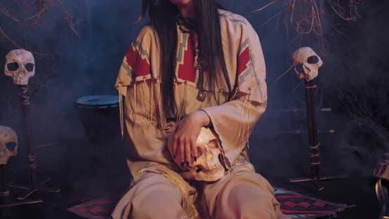 Native American Ritual, Young Woman Is Touching the Skull, Creepy Background