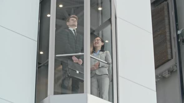 Cover Image for Riding Modern Glass Elevator