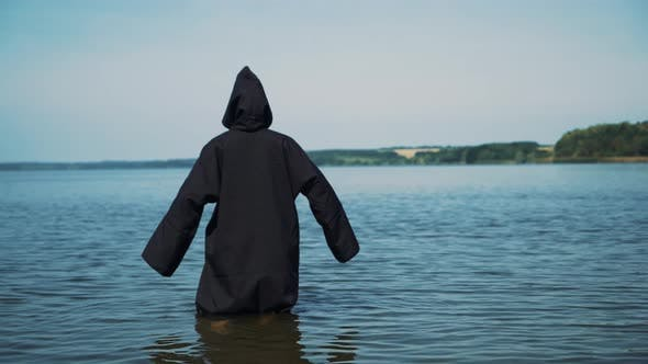 Thumbnail for Scary Figure in Black Mantle in the River