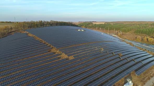 Thumbnail for Aerial Drone Footage. Flight Over Solar Panel Farm at Sunset Autumn Season