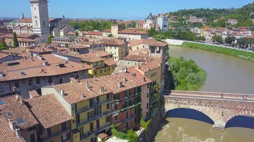 Panoramic aerial drone view of Verona, Italy. The drone moves away from the river Adige
