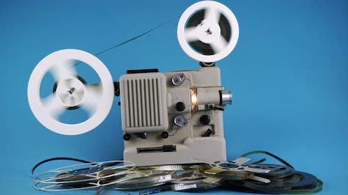 Rewinding Old Movies On Retro Movie Projector.
