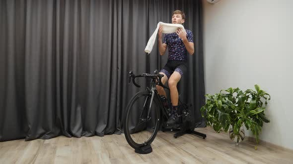 Thumbnail for Professional cyclist training on bicycle trainer indoors.