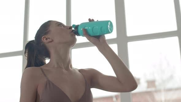 Sportswoman Making Water Sip