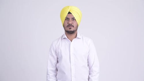 Bearded Indian Sikh Businessman Looking Shocked