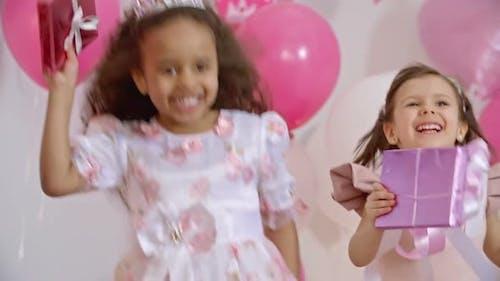 Joyous Little Princesses Jumping