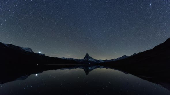 Thumbnail for Incredible Night View of Stellisee Lake with Matterhorn Peak in Swiss Alps