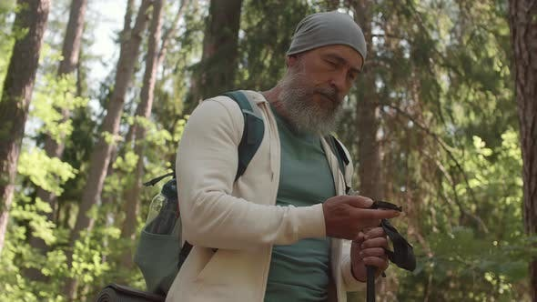 Thumbnail for Aged Man Using Compass during Hiking