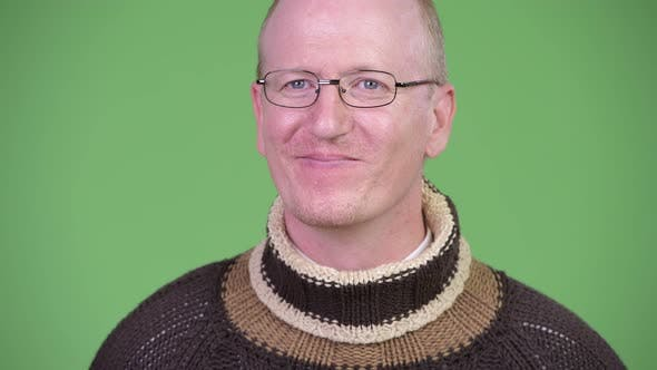 Thumbnail for Happy Mature Bald Man with Turtleneck Sweater Thinking