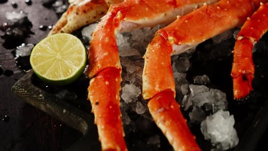 Fragrant Boiled Crab on a Cutting Board with Ice