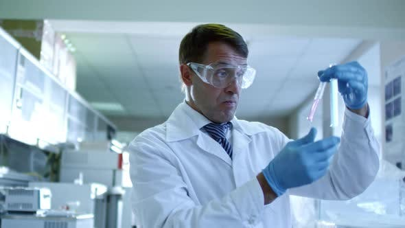 Thumbnail for Male Chemist Working with Test Tubes