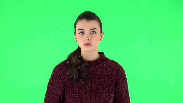Thumbnail for Girl Listens To Information Looking at Camera, Is Shocked and Very Upset. Green Screen