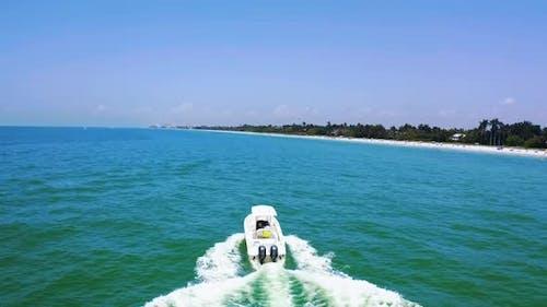 Motor Boat Sailing in Blue Sea or Ocean