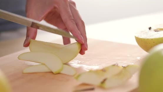Cutting apple into small pieces