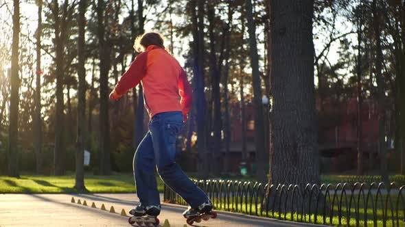 Thumbnail for Bearded Man on Roller Skates Performs a Complicated Technique of Roller Skating, Performs Various