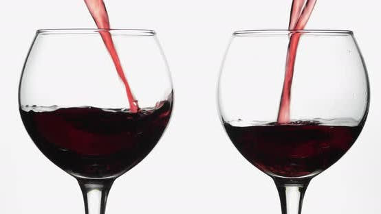 Thumbnail for Rose Wine. Red Wine Pour in Two Wine Glasses Over White Background
