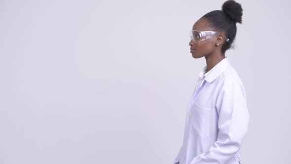 Thumbnail for Profile View of Young African Woman Doctor with Protective Glasses