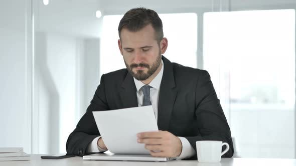 Thumbnail for Businessman Reading Documents, Paperwork