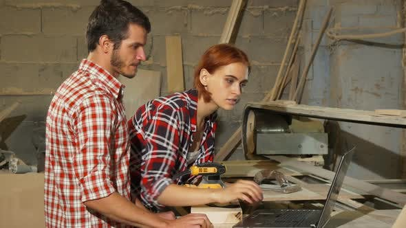 Thumbnail for Two Carpenters Using Laptop at Their Workshop While Making Furniture 1080p