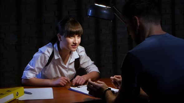 Woman Police Detective Is the Interrogation a Dangerous Criminal
