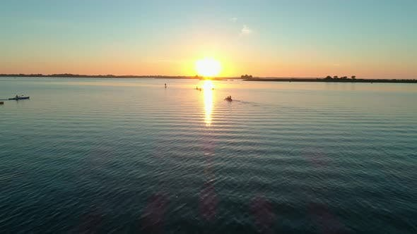 Thumbnail for Aerial Drone Footage. A Group of Tourists Are Kayaking. Beautiful Sunrise Over River