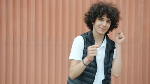 Slow Motion Portrait of Carefree Middle Eastern Teen Dancing Having Fun Outdoors