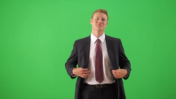 Thumbnail for Businessman standing looking at camera