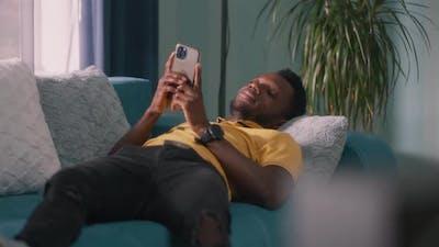 Positive Black Man Browsing Social Media