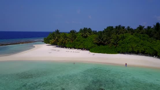 Wide overhead island view of a paradise sunny white sand beach and turquoise sea background in hi re