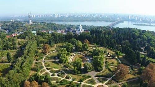 Drone Flight Over the Botanical Garden in Kiev in the Summer. Overlooking the Dnieper, Motherland