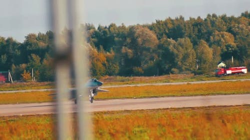 A Reactive Fighter Plane Taking Off the Runway