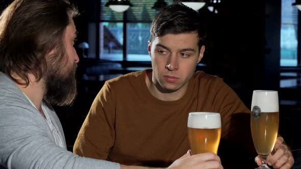 Thumbnail for Depressed Young Man Drinking at the Bar with His Friend