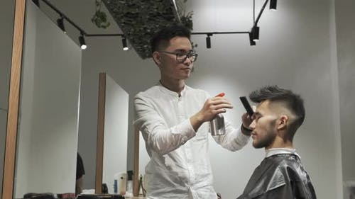 Asian Male Is Getting a Modern Haircut in Barber Shop