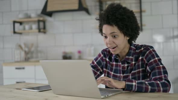Thumbnail for Cheerful African American Woman Get Surprise on Laptop