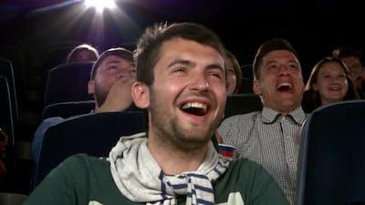 Young Man Watching Movie at Cinema: Comedy. Close Up