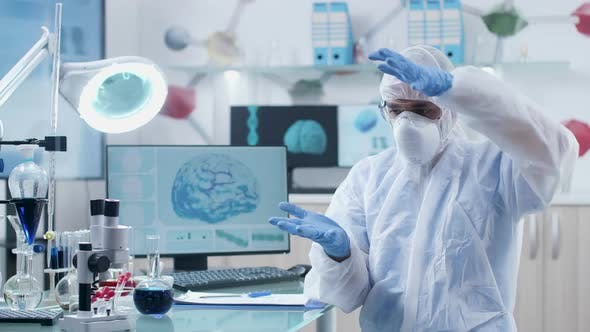 Thumbnail for Scientist in Modern Laboratory Wearing AR Glasses Works and Learns in 3D Space
