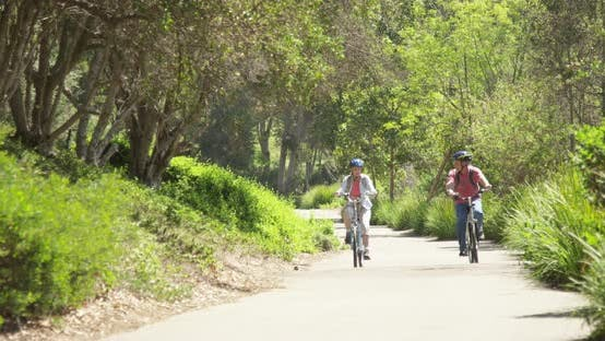 Thumbnail for Happy active senior couple cycling on trail
