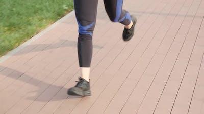 Legs running at sunrise