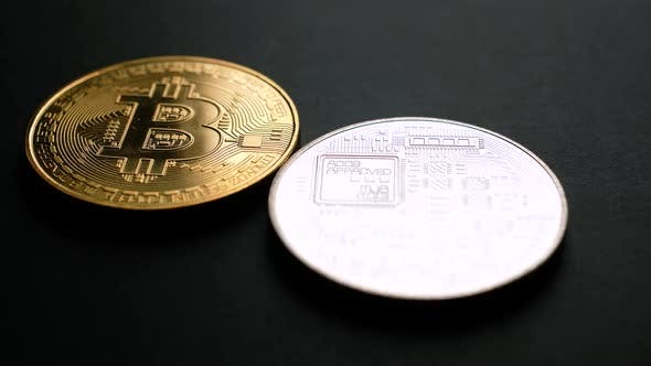 Golden and Silver Bitcoin Coins on Black