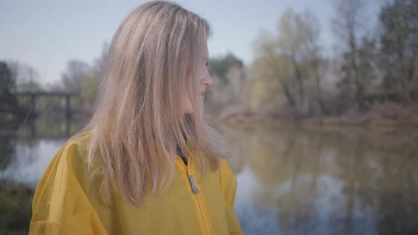 Thumbnail for Portrait Cute Young Beautiful Blond Woman Posing Near Lake or River