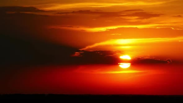 Thumbnail for Dramatic Red Sunrise on Dark Cloudy Sky