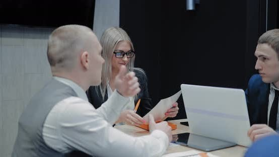 Employee Shows Documents to the Boss