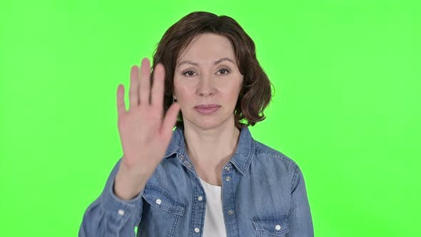 Thumbnail for Stop Gesture By Old Woman on Green Chroma Key Background