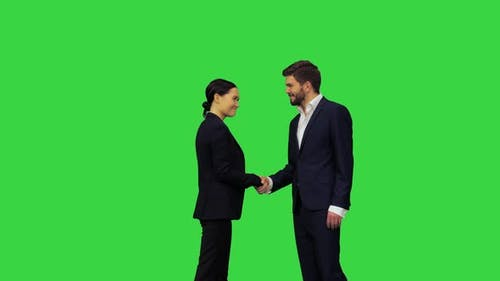 A Confident and Considerate Handshake of Two Business People on a Green Screen Chroma Key