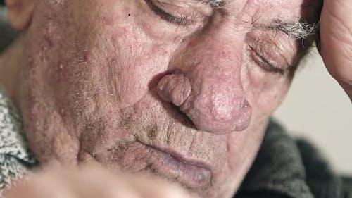old man sleeping deeply.Tired old man