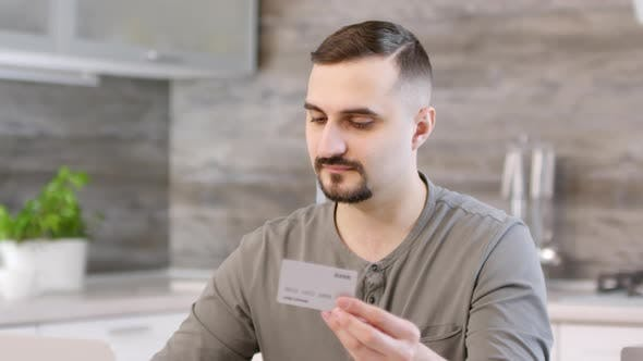 Thumbnail for Man Making Online Payment with Credit Card at Home