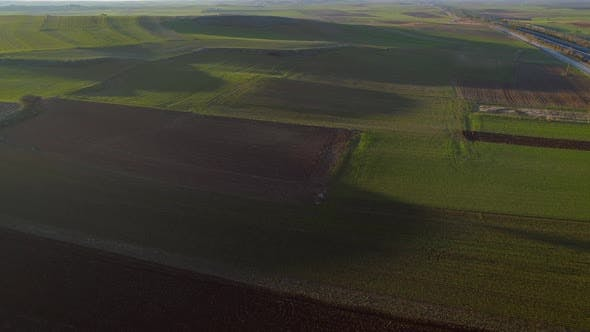 Thumbnail for Aerial view of a crop area with a lot of grass.