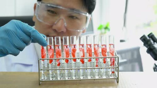 Scientist experimenting chemicals in science laboratory
